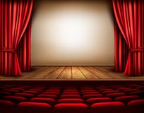 A theater stage with a red curtain, seats. Stock Photo