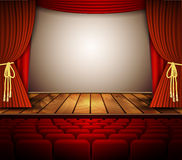 A theater stage with a red curtain, seats. Royalty Free Stock Images