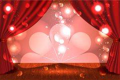 A theater stage with a red curtain and a spotlight. Royalty Free Stock Images