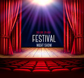 A theater stage with a red curtain and a spotlight. royalty free illustration