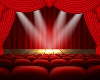 Theater stage with a red curtain and a spotlight Royalty Free Stock Photography