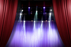 Theater stage red curtains opening for a live performance Royalty Free Stock Photography