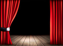 Theater stage with wooden floor and open red curtains. Stock Photo