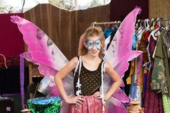 Theater student dressed as butterfly. Girl dressed as butterfly stands with hands on hip and smiles at the camera Stock Image