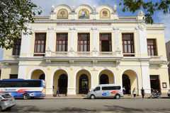 Theater Tomas Terry building in Cienfuegos. Cienfuegos, Cuba - 18 january 2016: People walking and taking pictures in front of Theater Tomas Terry building. The Stock Image