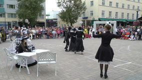 Theater troupe shows a street performance pantomime. Jyvaskyla, Finland - August 17, 2018: Theater troupe Option shows a street performance pantomime Arrival of stock video footage