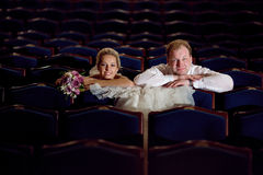 In the theatre. Young couple in the theatre stock photography
