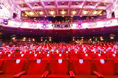 Theatre. Audience in red seats at old theatre / theater Royalty Free Stock Photo