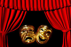 Theatre. Gold mask of tragedy and comedy between a red theatre curtain Stock Images