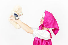 Theatre actress in costume of girl from fairy tale with her tedd Royalty Free Stock Photos