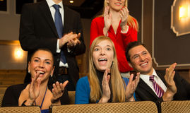 Theatre audience clapping and cheering stock image