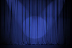 Theatre blue curtain with two lights cross Stock Photos