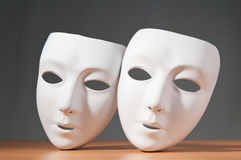Theatre concept. Masks with the theatre concept Royalty Free Stock Photo