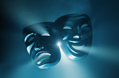 Theatre. Crying and smiling masks in hazy light Royalty Free Stock Images