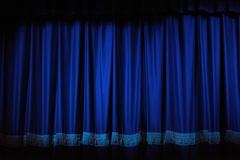 Theatre Curtains. Blue velvet old-fashioned theatre curtains with tassles. Ready for opening night royalty free stock photography
