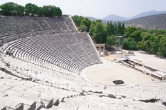 Ancient theatre of Epidaurus, Greece. View of an ancient circular amphitheater in Epidaurus, Peloponnese - Greece Royalty Free Stock Photo