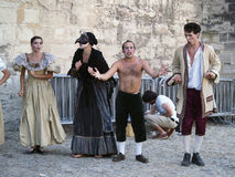 Theatre festival in Avignon, july 2005. Avignon, France - July 30th, 2005: troupe of actors in historical costumes advertising their performance on place in Royalty Free Stock Images