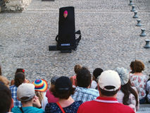 Theatre festival in Avignon, july 2012. Avignon, France - July 11th, 2012: an actor advertising his performance in front of the Palais des Papes Stock Images