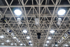 The  theatre hall ceiling lamps. The theater hall ceiling with bracing steel beams and flood light Stock Photo