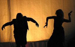 Theatre - life. Two silhouettes on a yellow background Stock Photos
