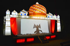 "Theatre of Light. A light theatre shows a stage show of shadows projected on to a backlit white screen to celebrate the Indian ""Diwali"" Festival of Light Stock Images"