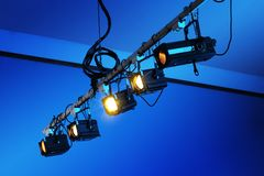 Theatre Lights. Spotlights hanging from the ceiling of an old theatre. European power plugs royalty free stock photos