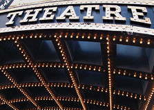 Theatre Lights. The bright lights of a theatre marquee in a downtown city Royalty Free Stock Photos
