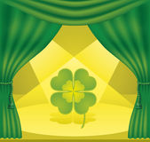 Theatre_luck. Theater scene with a green curtain, yellow backdrop and lit quarter-foil Royalty Free Stock Photo