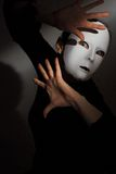 Theatre Mask. A woman wearing a theatre mask Stock Photo