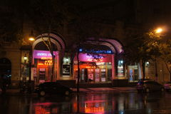 Theatre at night, buenos aires. Theatre in the rain at night, lights reflecting in the puddles from the rain stock photography