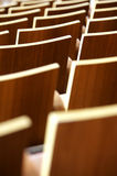 Theatre Seating. A theatre of wooden chairs Royalty Free Stock Photography