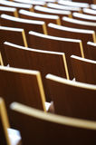 Theatre Seating. A theatre of wooden chairs Stock Photos