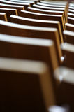 Theatre Seating. A theatre of wooden chairs Royalty Free Stock Photo