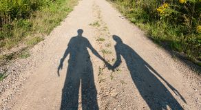 Theatre of shadows boy and girl on rural path Royalty Free Stock Photos