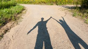 Theatre of shadows boy and girl on rural path Stock Image