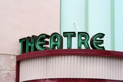Theatre Sign. Green theatre sign on pink building Stock Photos