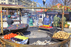 Theatre Square. Enormous Mangal. MOSCOW, RUSSIA - April 24.2016: Open-air cafe. Enormous frying pan, mangal and fresh vegetables Royalty Free Stock Photography