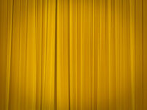 Theatre stage with closed curtains. Stage of the theatre with yellow curtains closed Stock Images