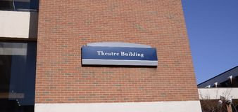 Theatre Department at a College. Theatre or theater is a collaborative form of fine art that uses live performers, typically actors or actresses, to present the royalty free stock photography