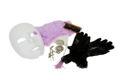Theatre time. White Mask, Delicate pastel feather Fan with tassles, Lace Gloves with a delicate pattern, Antique opera glasses used to view distant events royalty free stock photo