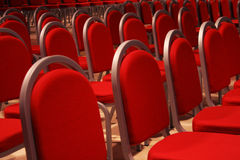 Theatre waiting. Red Theatre chairs lines with a wide perspective Stock Images