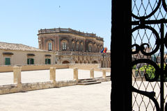 The theatre through a wrought iron gate, noto Stock Image