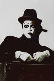 Theatrical actor with dark makeup on her face with a suitcase Stock Images