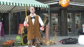 Theatrical clown street performance. Jyvaskyla, Finland - August 17, 2018: Theatre from Estonia Royal Giraffe shows street performance Clown-power during the stock video