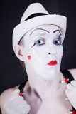 Theatrical clown in white hat Royalty Free Stock Photo