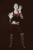 Theatrical funny clown with  big red bow Royalty Free Stock Images