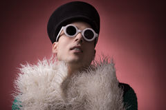 Theatrical gay homosexual portrait. One young adult man, theatrical gay homosexual portrait, fur stock photo