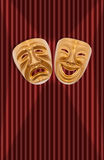 Theatrical mask. Comedy and tragedy theatrical mask on a curtain Stock Image