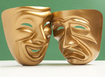 Theatrical mask. Comedy  and Tragedy theatrical mask on a green background Royalty Free Stock Image