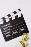 Theatrical mask and film clapper Royalty Free Stock Photos